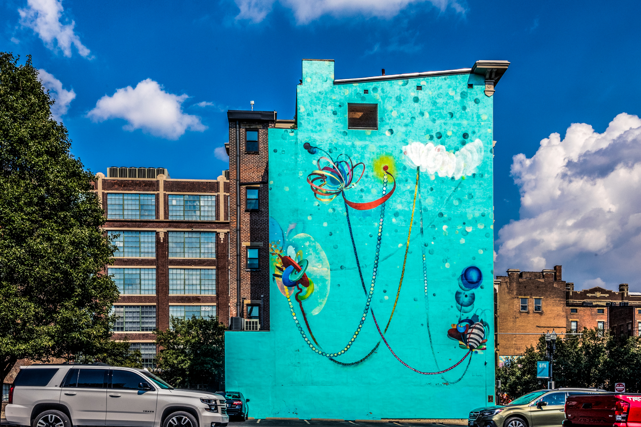 "Kim is an artist. You may recognize his work if you've ever been to 12th and Vine Streets in Over-the-Rhine. A mural of his painting ""Energy and Grace"" can be seen on the side of{ }16 E. 12th Street. / Image: Catherine Viox // Published: 10.11.20"