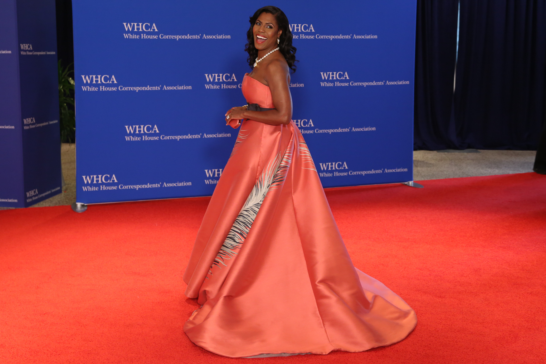 Omarosa may be out of the White House, but she came to the White House Correspondents' Dinner dressed with a vengeance. That color is perfect on her skin and the silhouette is as dramatic as she was on The Apprentice (Amanda Andrade-Rhoades/DC Refined)