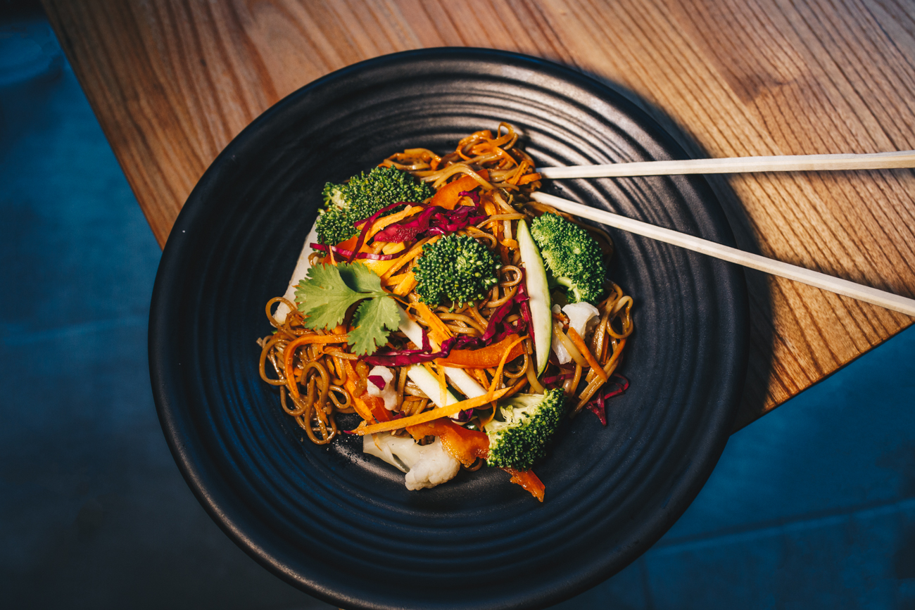 Super Monk Noodles: bed of buckwheat soba noodles with stir-fried zucchini, carrots, broccoli, beansprouts, shiitake mushrooms, and onions garnished with red cabbage / Image: Catherine Viox // Published: 4.22.19