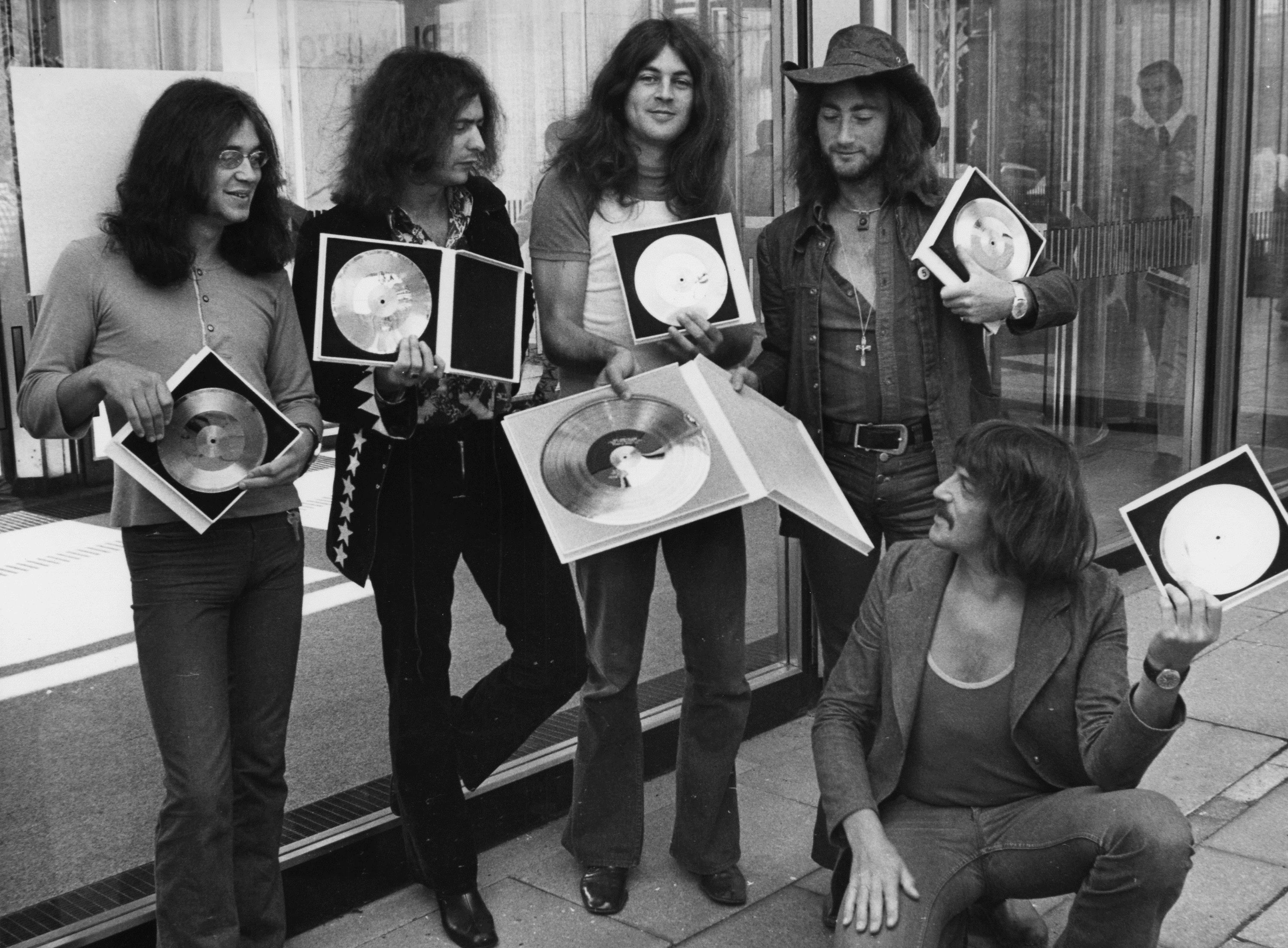 "In this Sept. 1, 1971, file photo, British rock band Deep Purple present their golden record they received in West Berlin for the sales of their latest album, ""Deep Purple in Rock,"" in West Germany. The groundbreaking Los Angeles rap act N.W.A. will join a quartet of 1970s era FM radio rockers, Chicago, Cheap Trick, Deep Purple and Steve Miller as 2016 inductees into the Rock and Roll Hall of Fame announced Thursday, Dec. 17, 2015. (AP Photo/Edwin Reichert, File)"