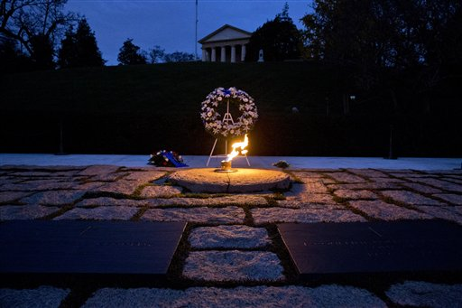 The eternal flame shines in the early morning light at the grave of John F. Kennedy at Arlington National Cemetery.