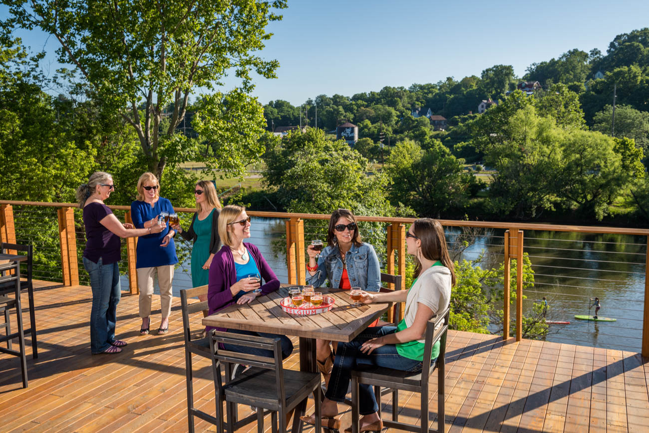 New Belgium Brewing Company features a riverside deck where you can enjoy views of the French Broad River. ADDRESS: 21 Craven Street, Asheville, NC (28806) / Image courtesy of Explore Asheville // Published: 12.29.18