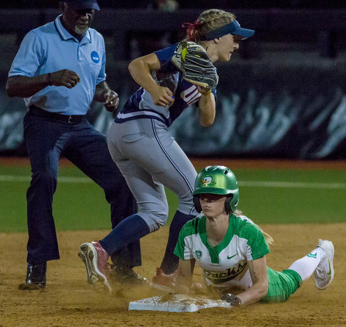 Ducks designated player Alexis Mack (#10) slides in to succesfully steal second base. The No. 3 Oregon Ducks defeated the University of Illinois Chicago Flames 13-0 with the run-rule on Saturday night at Jane Sanders Stadium. The Ducks scored in every inning and then scored nine runs at the bottom of the fourth. The Oregon Ducks are now 22-0 in NCAA regional games. The Oregon Ducks play Wisconsin next on Saturday, May 20 at 2pm at Jane Sanders Stadium. Photo by Aaron Alter, Oregon News Lab