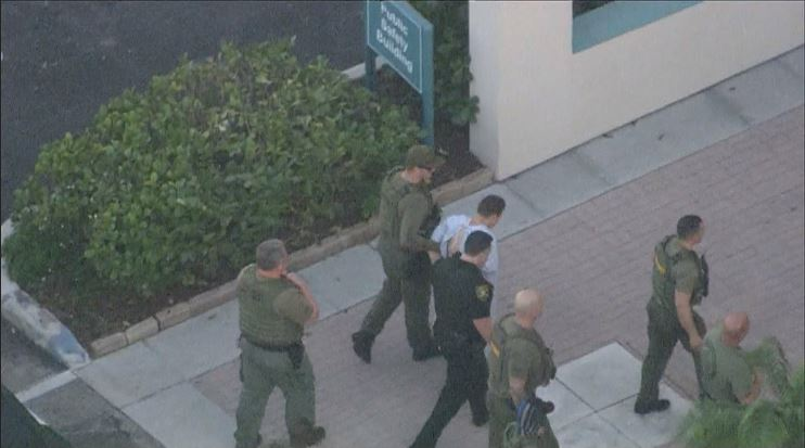 Suspect Nikolas Cruz is taken into the Broward County Jail. (WPEC)<p></p>
