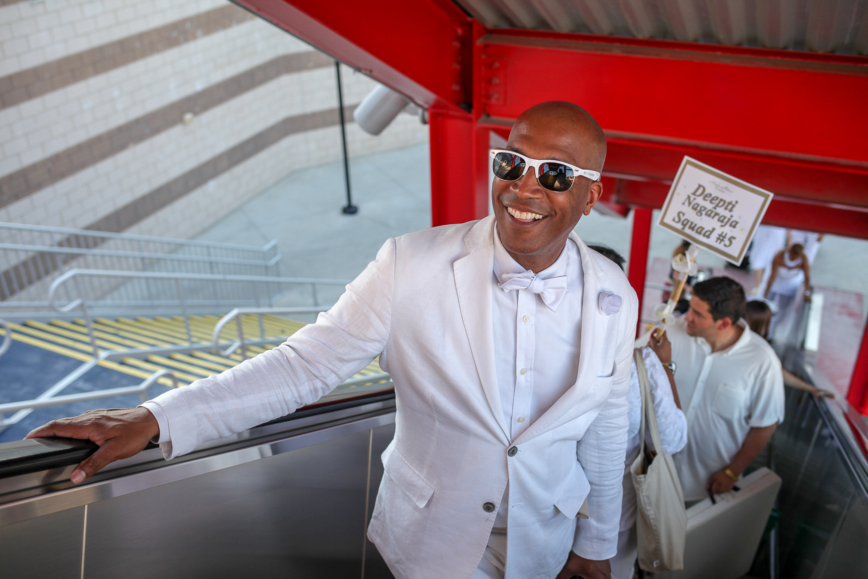 This August was hot and damp, but Washingtonians still dressed their best. Here are some of our favorite looks from this month, like Barnette Holston's all-white ensemble at Diner en Blanc. (Amanda Andrade-Rhoades/DC Refined)