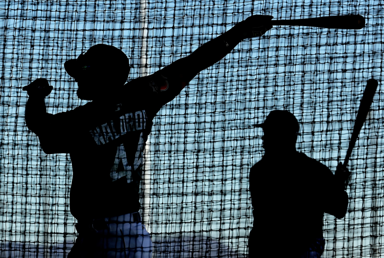 Seattle Mariners' Kyle Waldrop, left, and Guillermo Heredia practice in a batting cage during spring training baseball practice, Tuesday, Feb. 21, 2017, in Peoria, Ariz. (AP Photo/Charlie Riedel)
