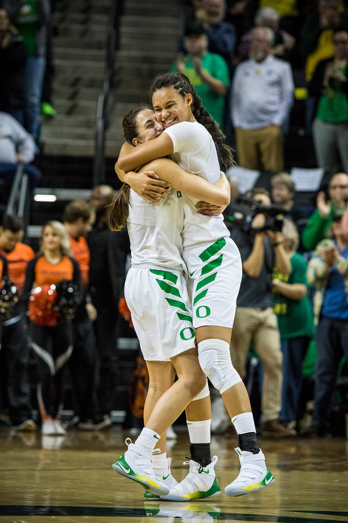 Oregon Ducks Maite Cazorla (#5) and Satou Sabally (#0) embrace after the game in celebration of their victory. The Oregon Ducks defeated the Oregon State Beavers 75-63 on Sunday afternoon in front of a crowd of 7,249 at Matthew Knight Arena. The Ducks and Beavers split the two game Civil War with the Beavers defeating the Ducks on Friday night in Corvallis. The Ducks had four players in double digits: Satou Sabally with 21 points, Maite Cazorla with 16, Sabrina Ionescu with 15, and Mallory McGwire with 14. The Ducks shot 48.4% from the floor compared to the Beavers 37.3%. The Ducks are now 7-1 in conference play. Photo by Rhianna Gelhart, Oregon News Lab
