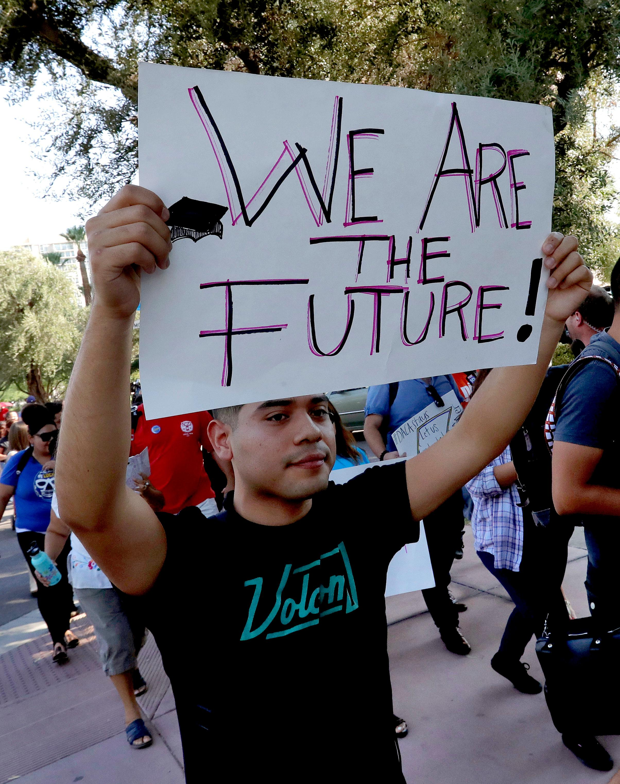 Deferred Action for Childhood Arrivals (DACA) supporters march to the Immigration and Customs Enforcement office to protest shortly after U.S. Attorney General Jeff Sessions' announcement that the Deferred Action for Childhood Arrivals (DACA), will be suspended with a six-month delay, Tuesday, Sept. 5, 2017, in Phoenix.{&amp;nbsp;} (AP Photo/Matt York)<p></p>