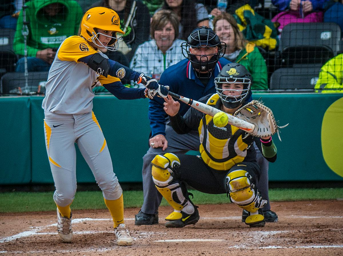 Cal Bears Kylie Reed (#3) swings at the ball. The Oregon Ducks defeated the Cal Bears 2-1 in game two of a three-game series. Photo by Rhianna Gelhart, Oregon News Lab