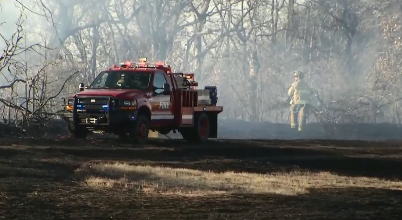 A grass fire is limiting visibility on I-35 Feb. 8 near Edmond. (KOKH/David Young)
