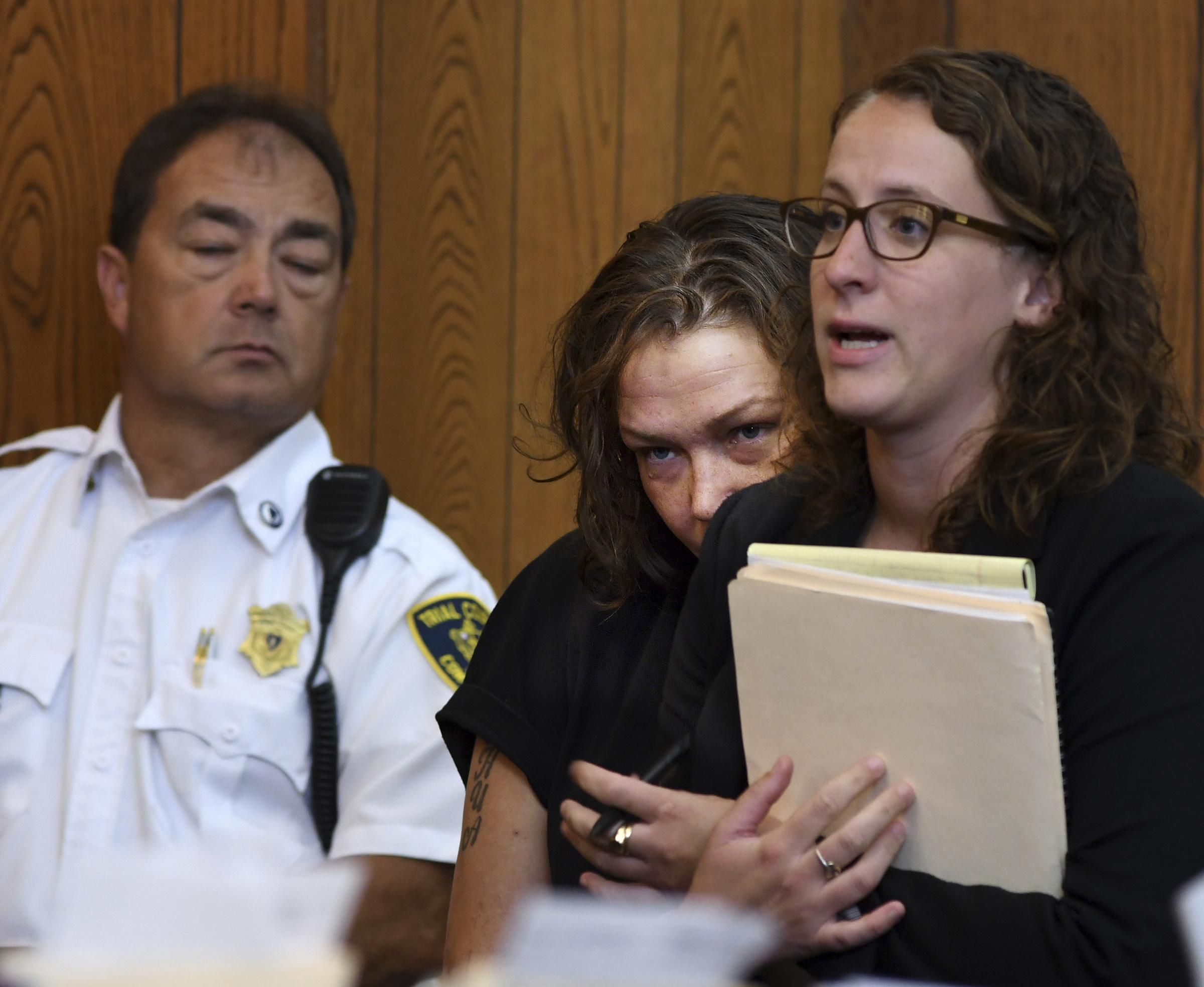 Leeann Rickheit, visible in center with attorney Hillary Knight at right. [T&G Staff/Christine Peterson]