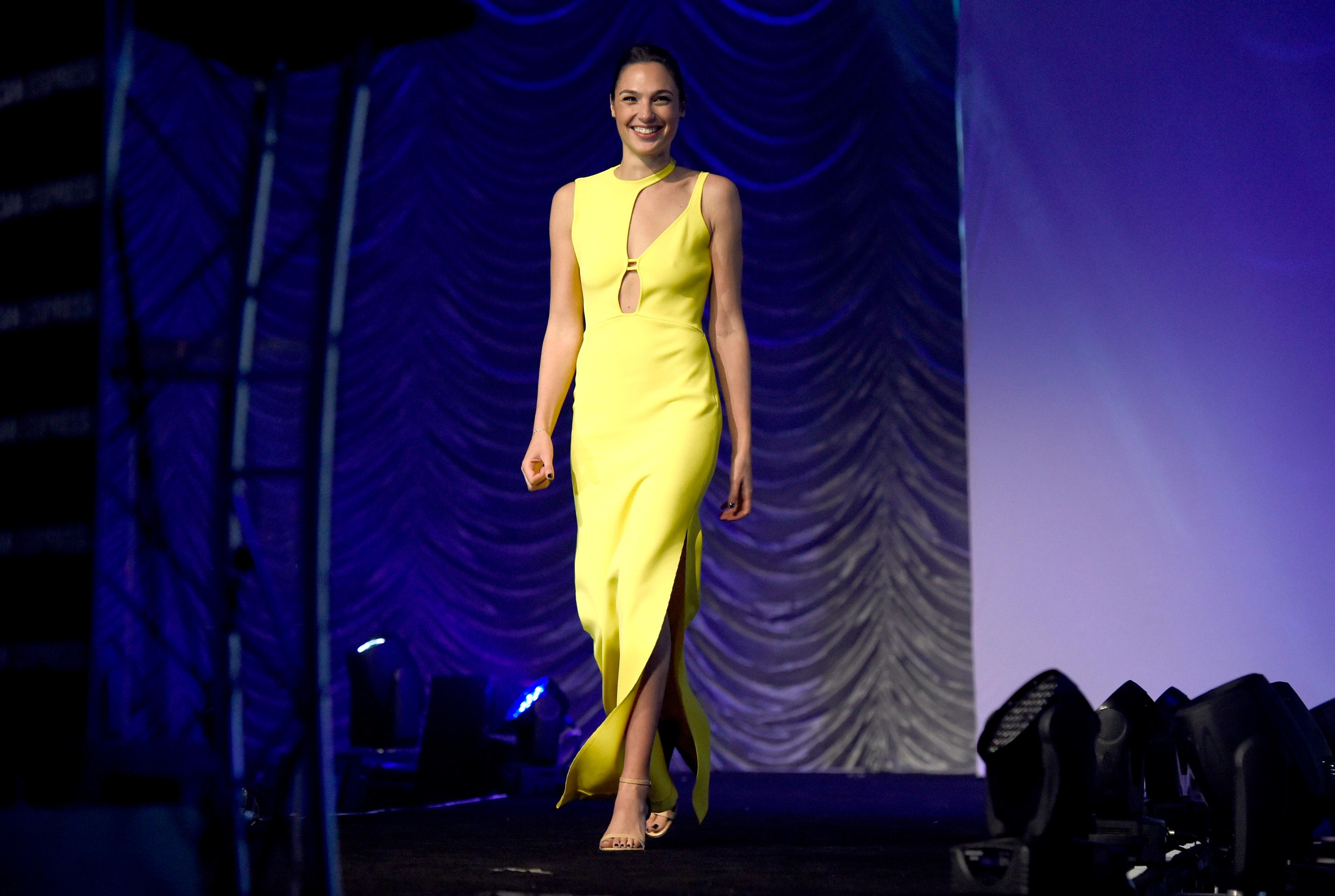 "Gal Gadot appears on stage to accept the rising star award-actress for ""Wonder Woman"" at the 29th annual Palm Springs International Film Festival on Tuesday, Jan. 2, 2018, in Palm Springs, Calif. (Photo by Chris Pizzello/Invision/AP)"