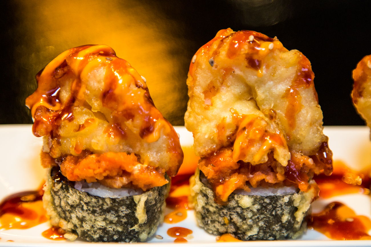 No Pain No Gain Roll: deep fried crab meat, cream cheese, spicy tuna, deep fried jumbo shrimp in a light spicy sauce with a garnish of eel sauce / Image: Catherine Viox // Published: 1.31.17