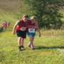 Middle school runner helps teammate across finish line