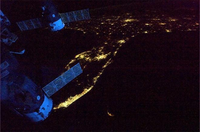 Spaceships glowing blue in the dawn as we leave Florida headed across the Atlantic.  (Photo & Caption: Col. Chris Hadfield, NASA)