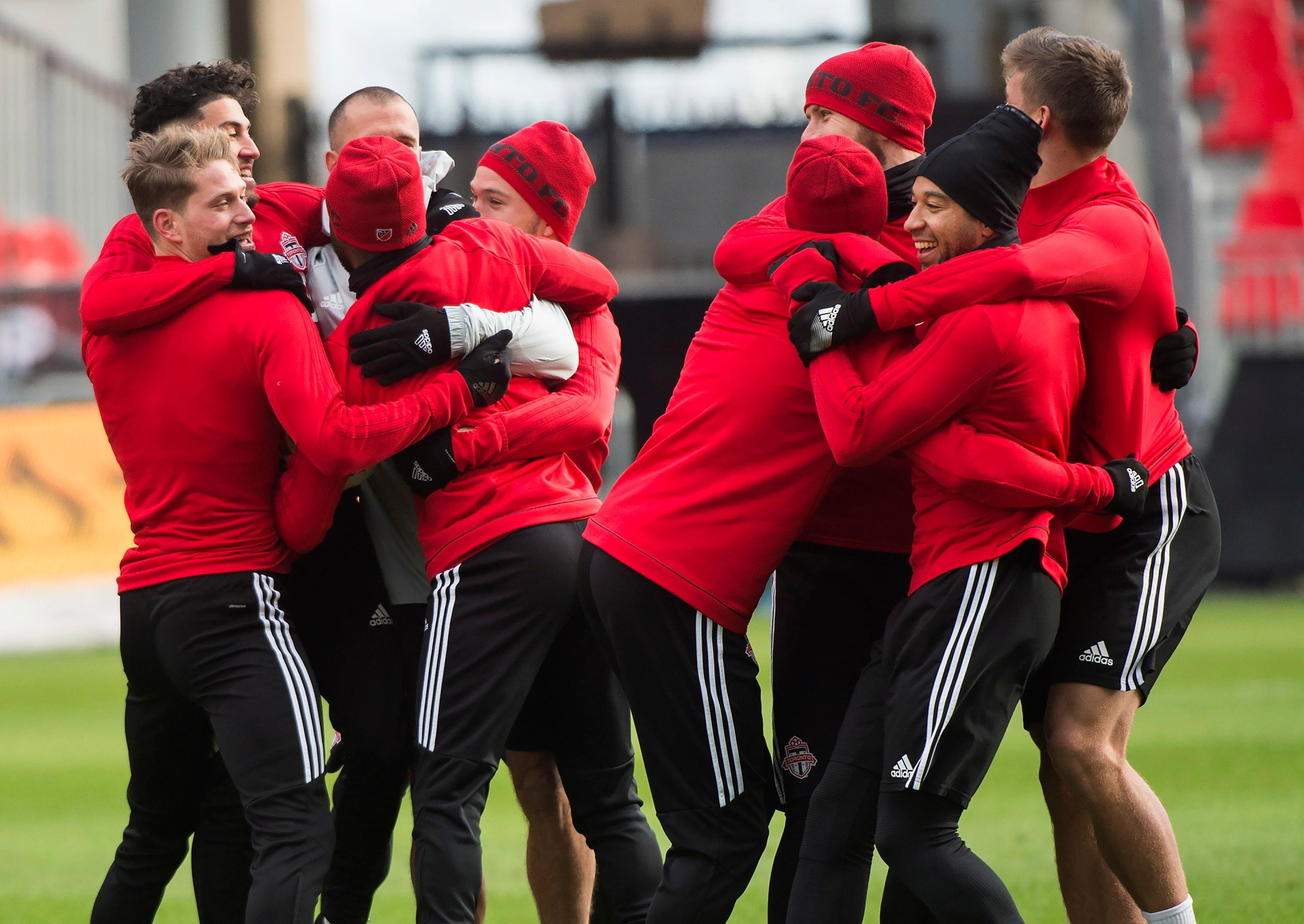 Toronto FC teammates joke around during practice ahead of the MLS Cup soccer final against the Seattle Sounders, in Toronto, Friday, Dec. 8, 2017. (Nathan Denette/The Canadian Press via AP)
