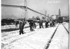 02_Clearing_snow_from_tracks_King_Street_station_Seattle_January_1950.jpg