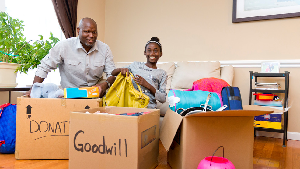 Dad and daughter sorting donations.jpg