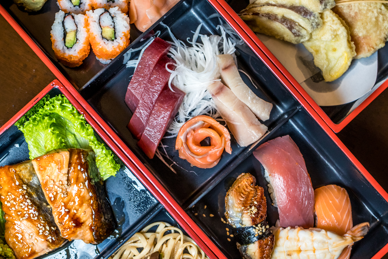 Box Dinner for Two: includes salmon, chicken, vegetables, sushi, and sashimi / Image: Catherine Viox{ }// Published: 1.3.21