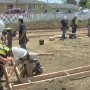 YouthBuild students begin constructing home for family in need thanks program's return