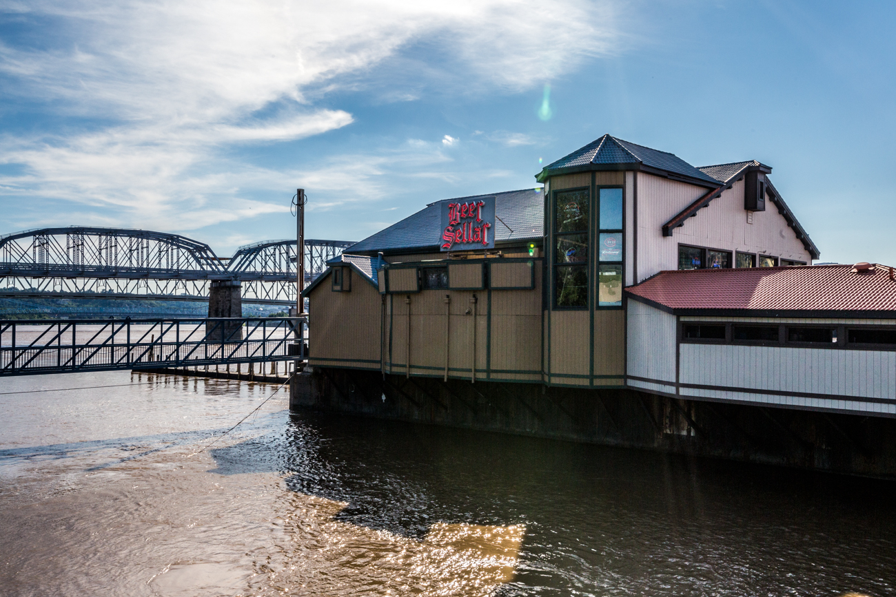 PLACE: Beer Sellar / ADDRESS: 301 Riverboat Row (Newport) / Beer Sellar sits on the water along the Kentucky side of the river, sharing a barge with Hooters. They have 64 beer taps that constantly vary, not to mention 100 bottled beers and a great bourbon selection to choose from. Aside from games like pool and shuffleboard to enjoy on the docked bar, they also provide a water taxi to shuttle you to or from home baseball and football games across the river. / Image: Catherine Viox // Published: 7.18.19