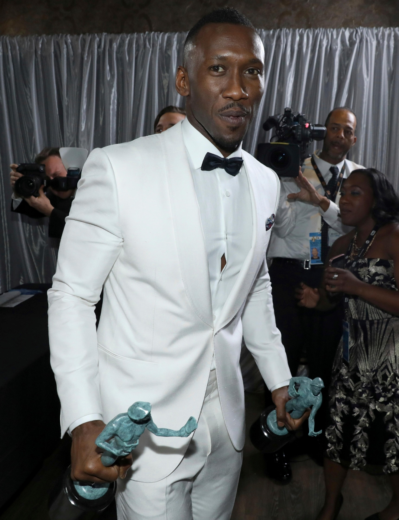 "Mahershala Ali poses backstage as he picks up his awards for outstanding performance by a male actor in a supporting role for ""Moonlight"" and outstanding performance by a cast in a motion picture for ""Hidden Figures"" at the 23rd annual Screen Actors Guild Awards at the Shrine Auditorium & Expo Hall on Sunday, Jan. 29, 2017, in Los Angeles. (Photo by Matt Sayles/Invision/AP)"