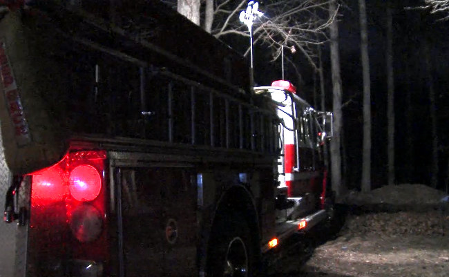 Spotlights were setup on a fire truck to assist investigators searching the dark, wooded-area where the skeletal remains were found. (abc3340.com)