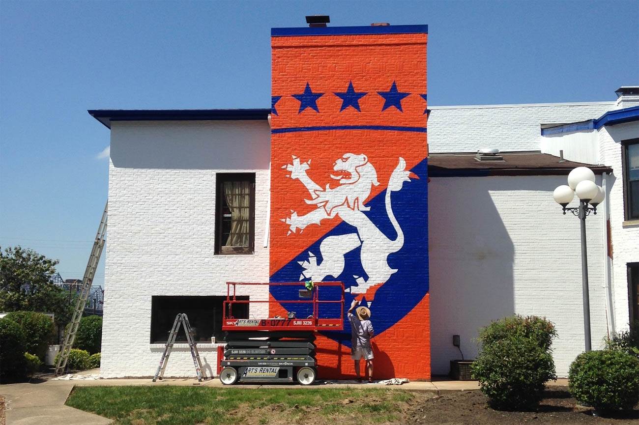 Their exterior mural of House of Orange was made using a giant stencil. / Image courtesy of BLDG Refuge // Published: 9.24.19