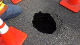 Developing sinkhole closes 1 eastbound lane of I-90 in Issaquah
