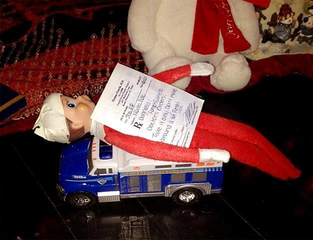 This Dec 11, 2013 photo shows a bandaged elf from the Elf on the Shelf with a prescription by the Christmas tree in the Boerman home in Charleston, S.C. Boerman procured a doctor's prescription after the elf fell from the chandelier during dinner.