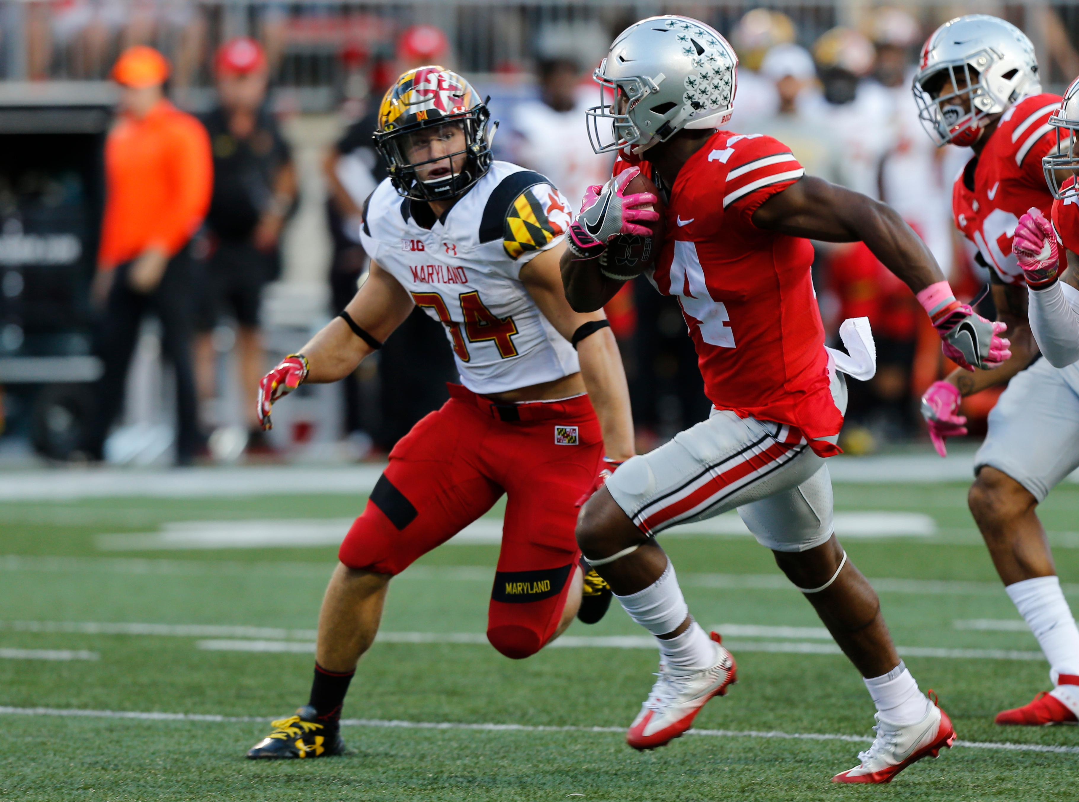 Ohio State receiver K.J. Hill, right, returns a punt as Maryland defender Jake Funk chases him during the first half of an NCAA college football game Saturday, Oct. 7, 2017, in Columbus, Ohio. (AP Photo/Jay LaPrete)