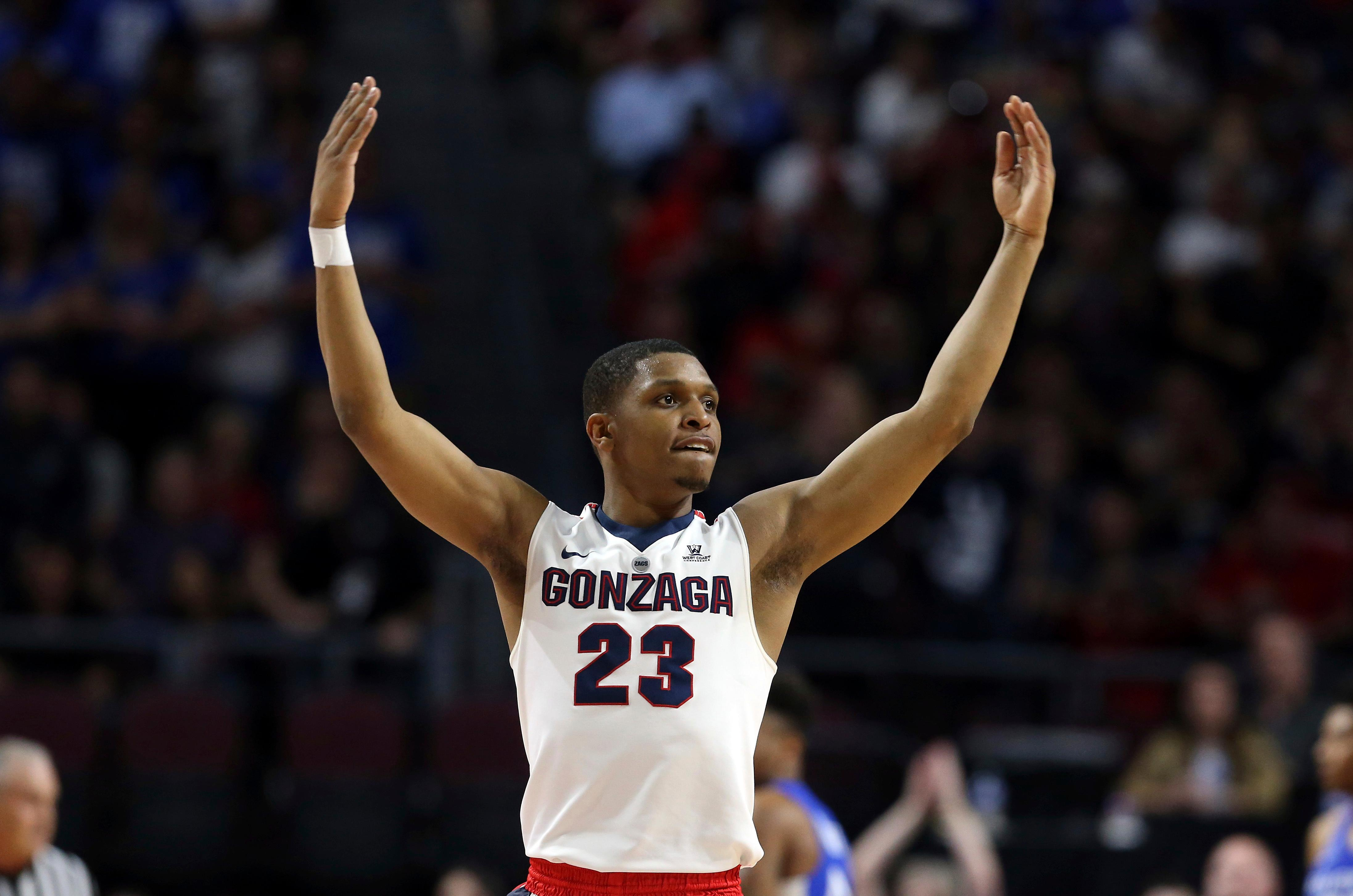 Gonzaga's Zach Norvell Jr. raises his hands to the crowd during the first half of the West Coast Conference tournament championship NCAA college basketball game against BYU Tuesday, March 6, 2018, in Las Vegas. (AP Photo/Isaac Brekken)