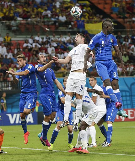 England's Gary Cahill (5) goes up to head the ball against Italy's Mario Balotelli (9) during the group D World Cup soccer match between England and Italy at the Arena da Amazonia in Manaus, Brazil, Saturday, June 14, 2014.