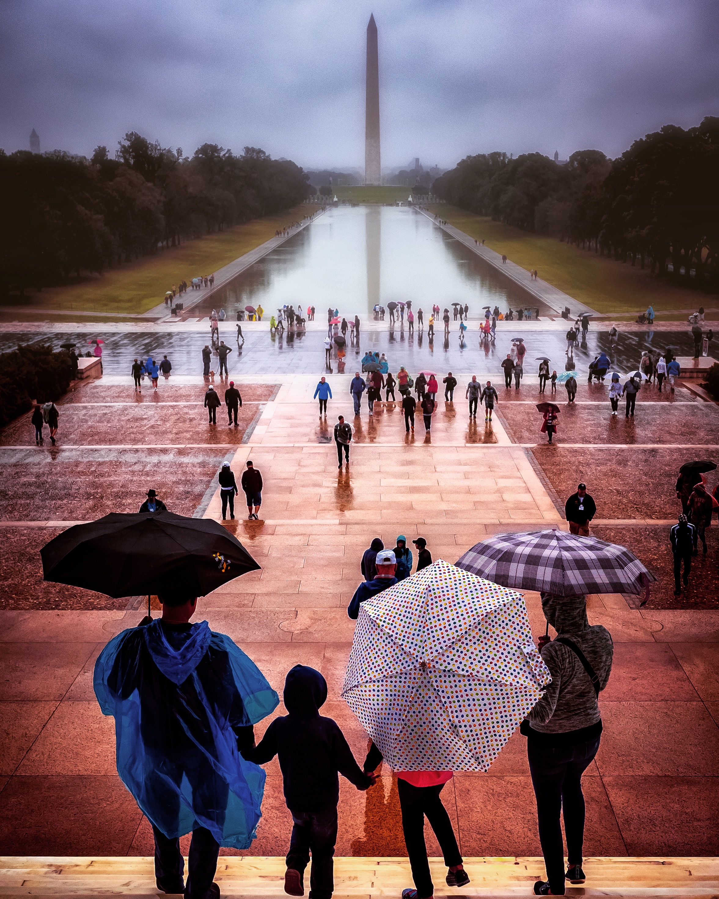 A family heading out into a sudden downpour along the steps of the Lincoln Memorial. Taken September, 2017. (Image: Adam Brockett)