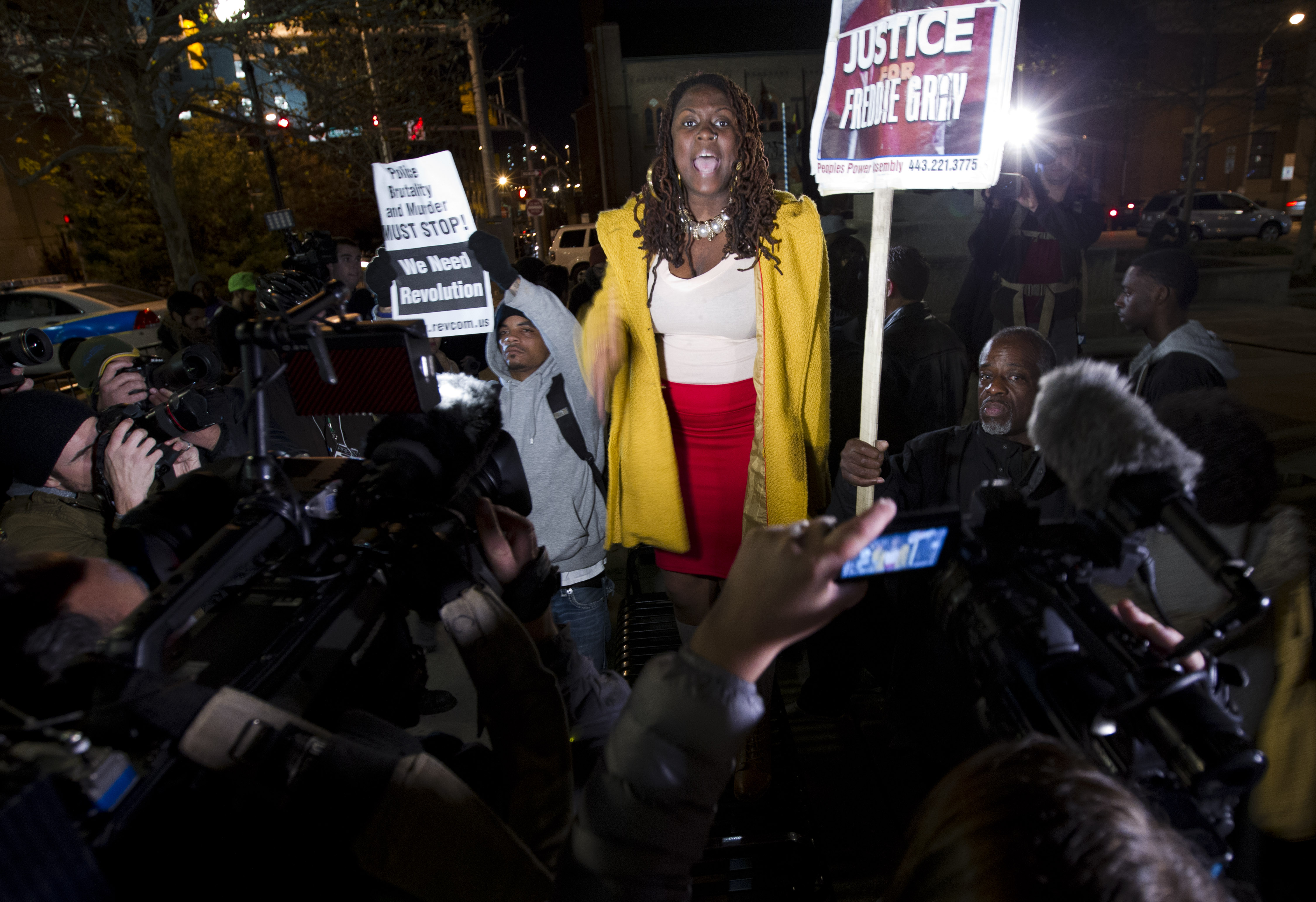 A demonstrator protests outside of the courthouse in response to a hung jury and mistrial for Officer William Porter, one of six Baltimore city police officers charged in connection to the death of Freddie Gray, Wednesday, Dec. 16, 2015, in Baltimore Md.  (AP Photo/Jose Luis Magana)