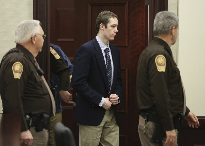 Defendant David Eisenhauer enters Montgomery County Circuit Court in Christiansburg, Va., Wednesday, Feb. 7 2018. Eisenhauer is accused of killing 13-year-old Nicole Madison Lovell on Jan. 27, 2016. (Matt Gentry/The Roanoke Times via AP, Pool)