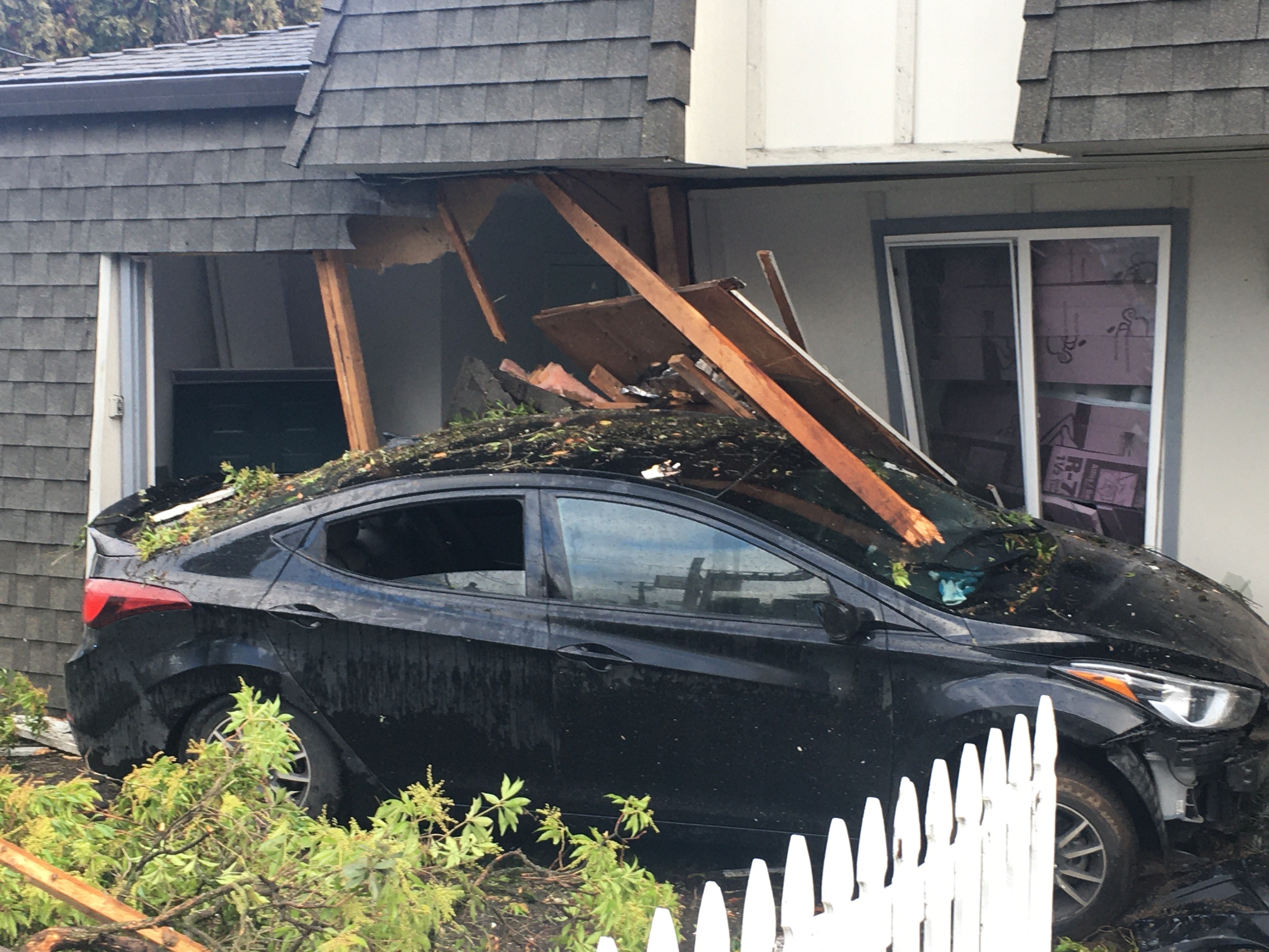 A driver crashed into an apartment in Southeast Portland on Jan. 1, 2020. Photo by Rodney Rocker{ }
