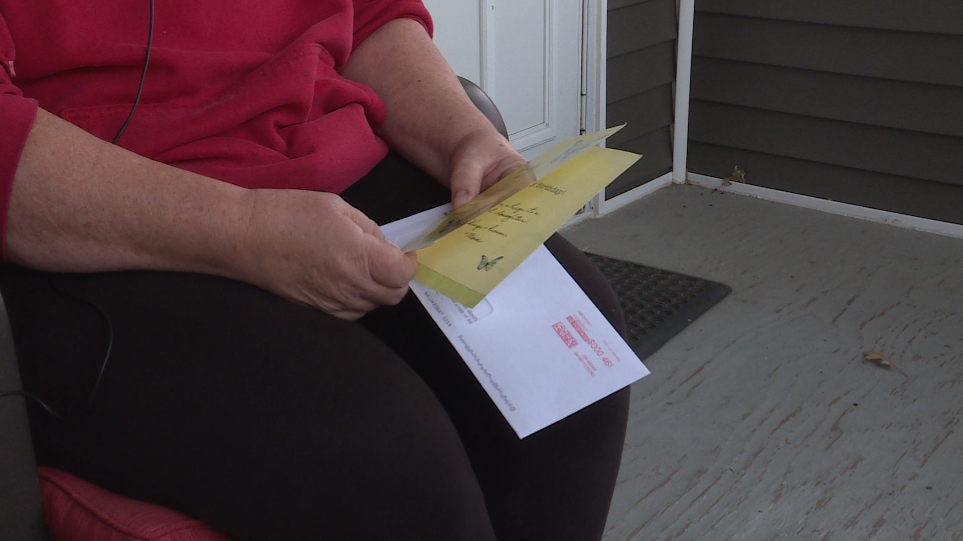 Woman says money was ripped from an envelope inside her mailbox