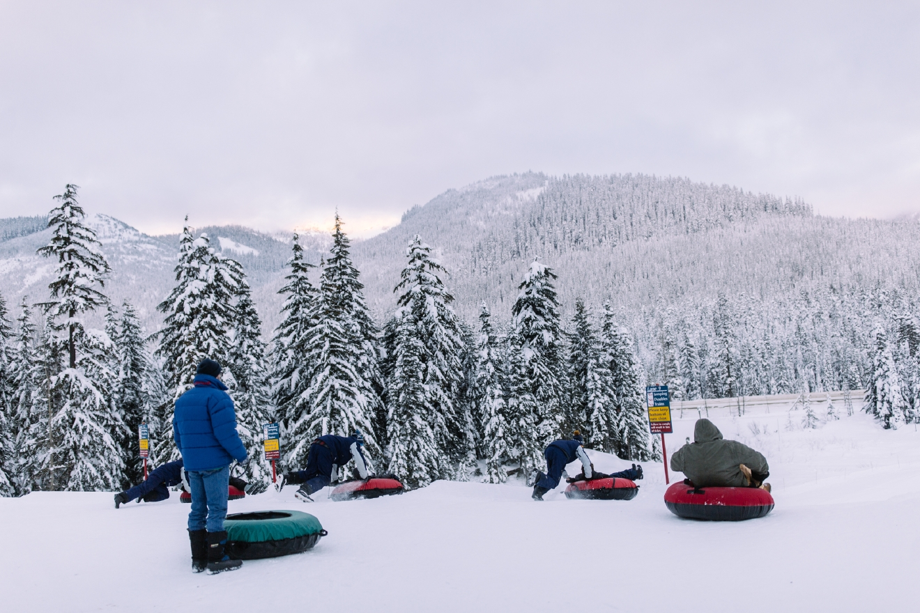 It's officially Tubing Season at the Summit at Snoqualmie! With more than a dozen groomed lanes, a covered conveyor belt to get you up the hill, inner tubes and everything you need, the Tubing Center is the perfect place to play in the snow. To learn more and buy tickets for your next trip go to http://www.summitatsnoqualmie.com/mountains/tubing. (Image: Joshua Lewis / Seattle Refined)