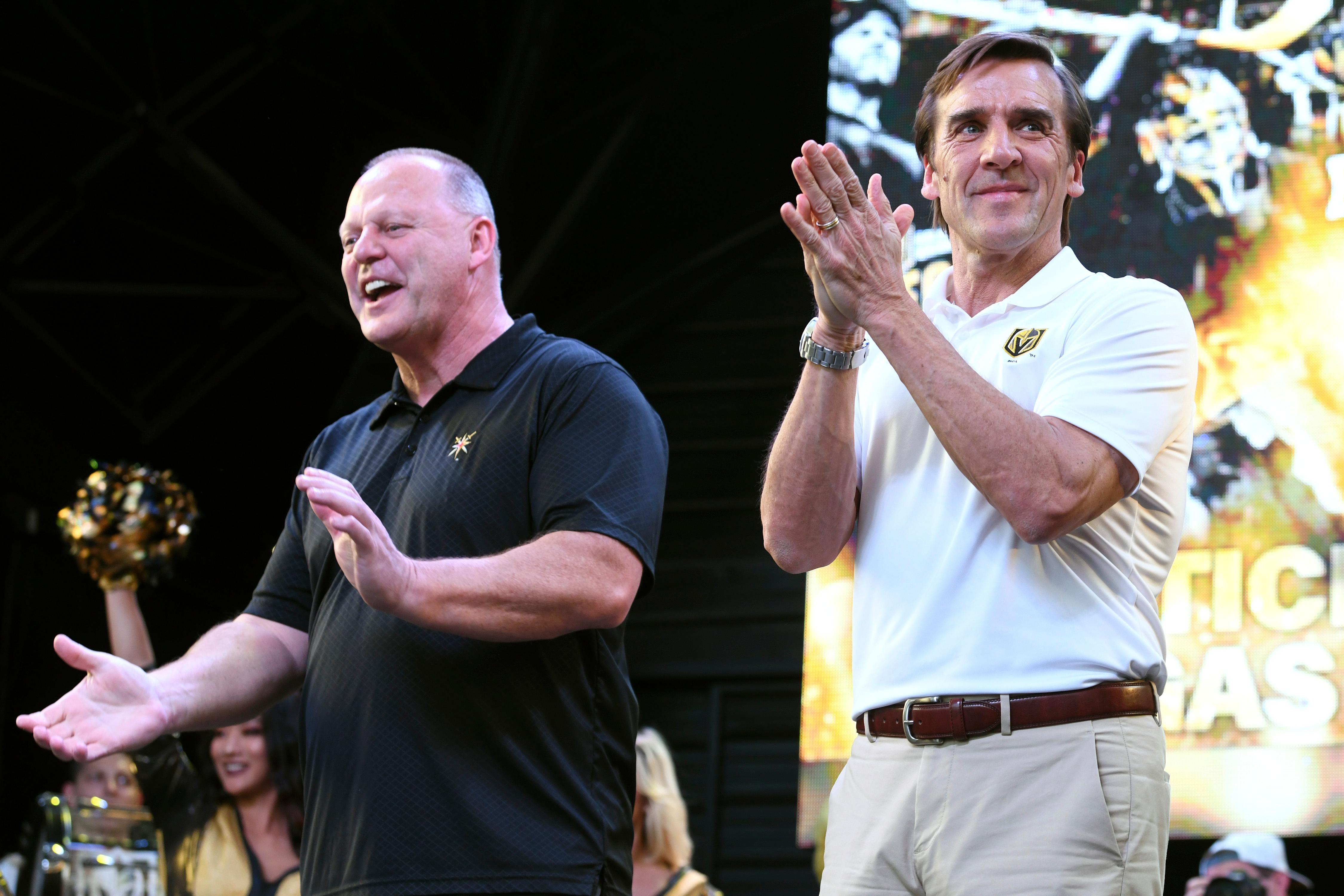 Vegas Golden Knights head coach Gerard Gallant and general manager George McPhee applaud the crowd during a Vegas Golden Knights Stick Salute to Vegas fan appreciation rally at the Fremont Street Experience Wednesday, June 13, 2018. CREDIT: Sam Morris/Las Vegas News Bureau