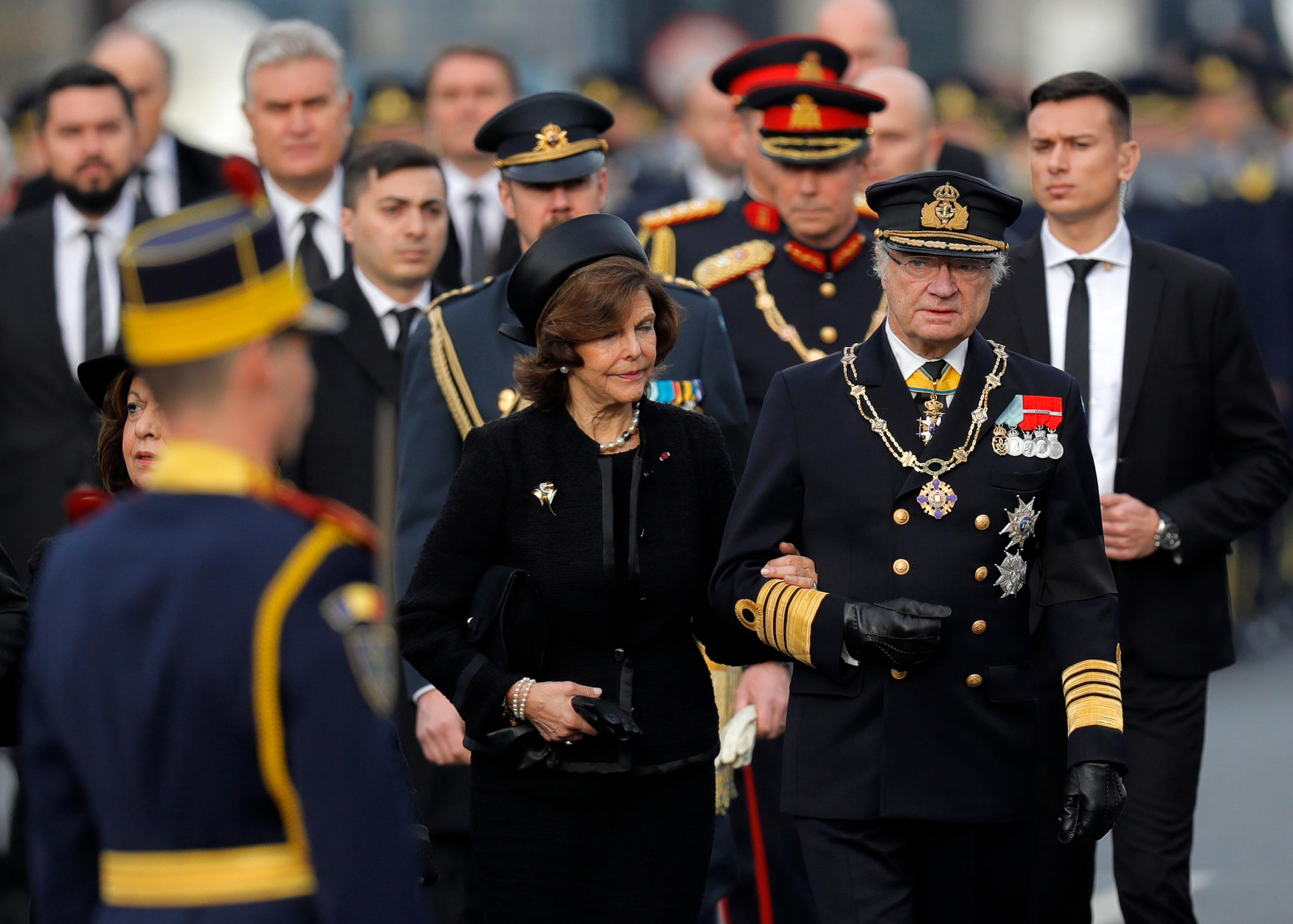 Sweden's King Carl XVI Gustaf, front right, and Queen Silvia, center, arrive for the funeral ceremony in tribute to late Romanian King Michael in Bucharest, Romania, Saturday, Dec.16, 2017. Thousands waited in line to pay their respects to Former King Michael, who ruled Romania during WWII, and died on Dec. 5, 2017, aged 96, in Switzerland. (AP Photo/Vadim Ghirda)