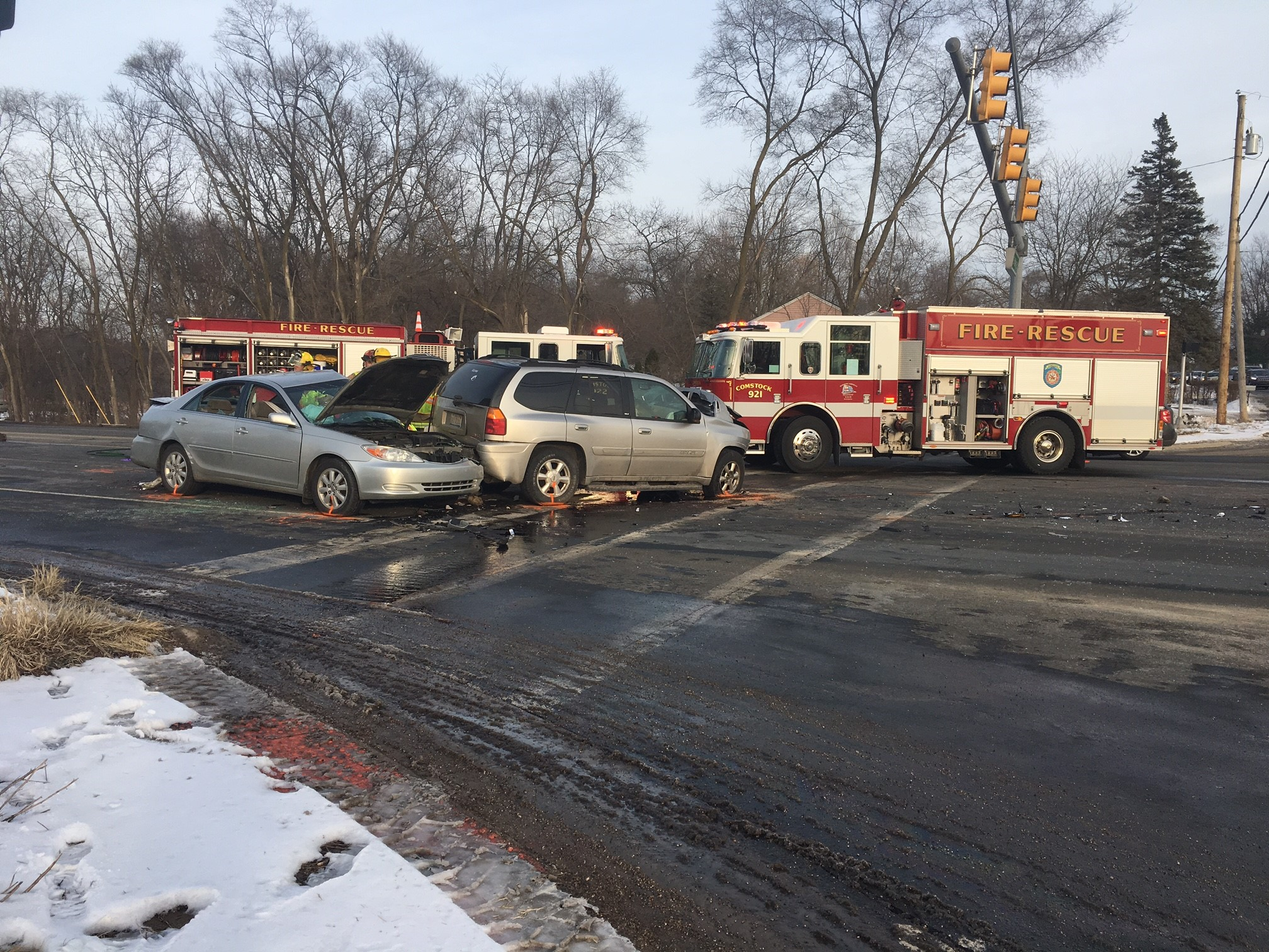 One person died and another is in critical condition following a four-car crash that forced the closure of the intersection of Sprinkle Road and East Main Street. (WWMT/Mike Krafcik)