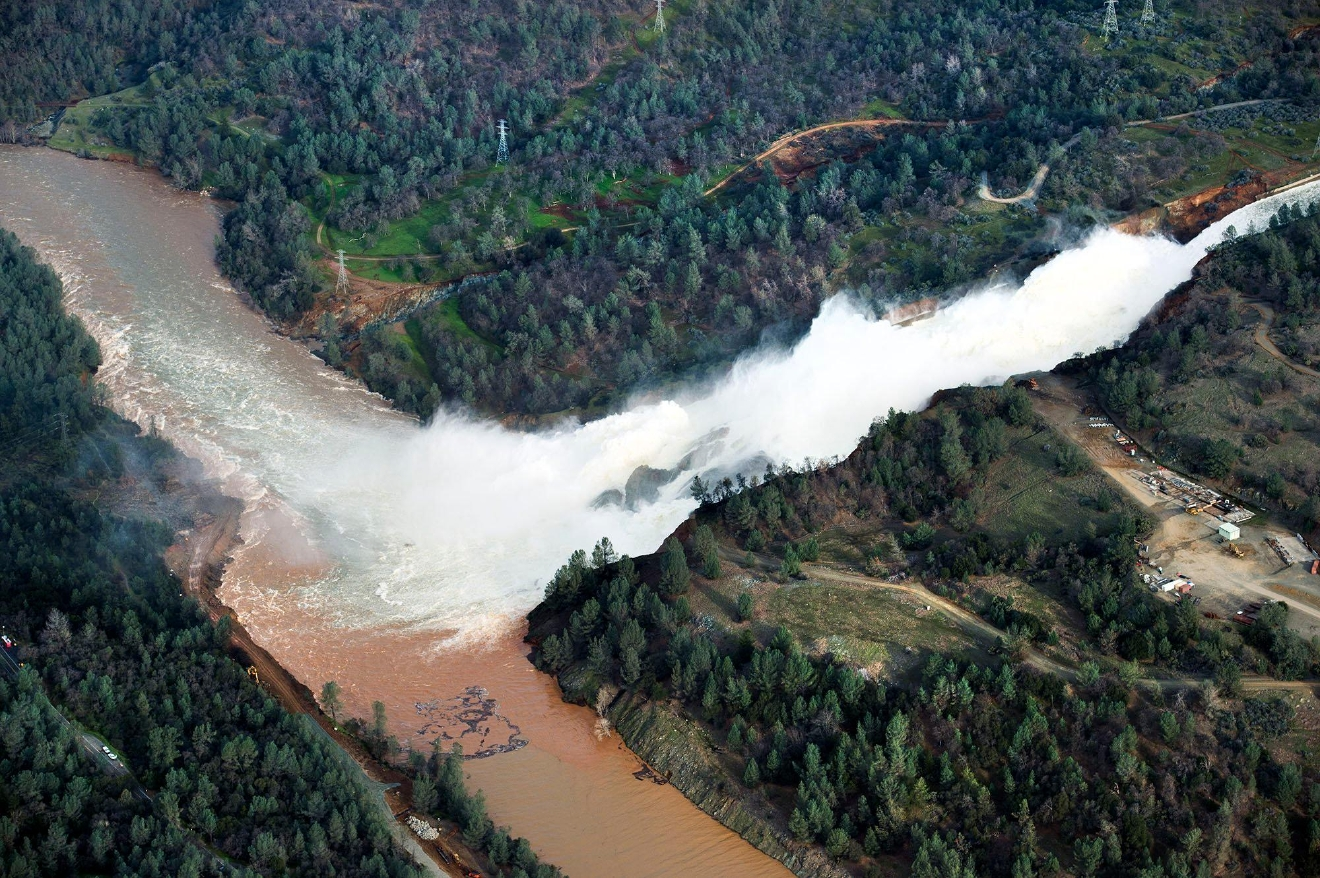 Water continues to run down the main spillway at Lake Oroville on Monday, Feb. 13, 2017, in Oroville, Calif.  The water level dropped Monday behind the nation's tallest dam, reducing the risk of a catastrophic spillway collapse and easing fears that prompted the evacuation of nearly 200,000 people downstream.  Sunday afternoon's evacuation order came after engineers spotted a hole on the concrete lip of the secondary spillway for the 770-foot-tall Oroville Dam and told authorities that it could fail within the hour. (Randy Pench/The Sacramento Bee via AP)