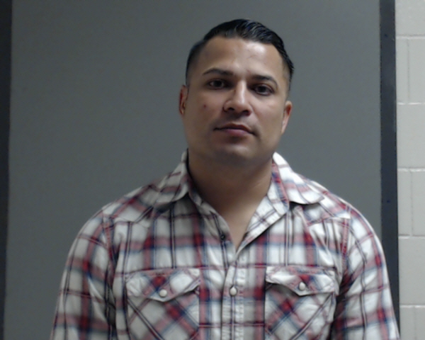 McAllen police Officer Michael Ray Basaldu, 37, of Edinburg is charged with assault causing bodily injury, a Class A misdemeanor. (Photo courtesy of the Hidalgo County Sheriff's Office.)