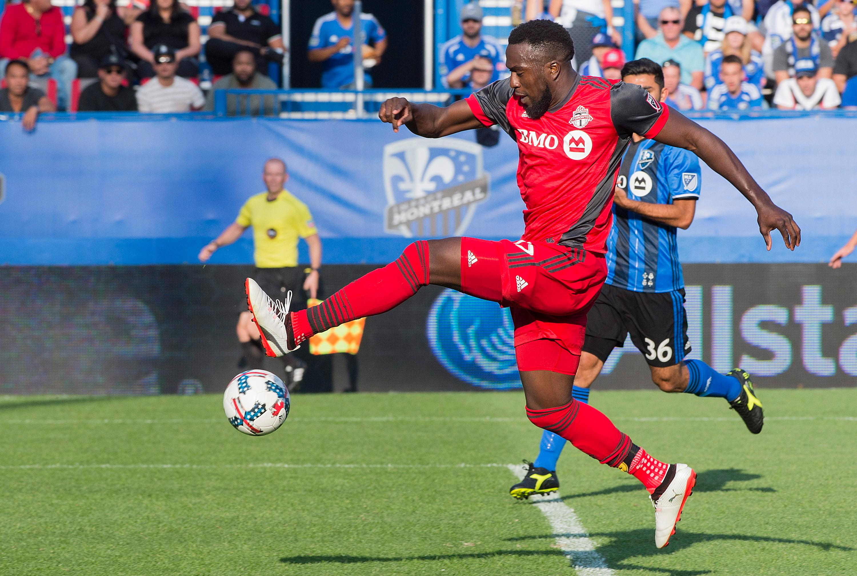 FILE - In this Sunday, Aug. 27, 2017 file photo, Toronto FC's Jozy Altidore scores against the Montreal Impact during second half MLS soccer action in Montreal. Toronto FC needs to beat the defending champion Seattle Sounders to cap their record-breaking regular season with an MLS Cup crown. Led by Altidore, fellow U.S. international Michael Bradley and 2015 league MVP Sebastian Giovinco, Toronto set a league record with 69 points this season.(Graham Hughes/The Canadian Press via AP, File)