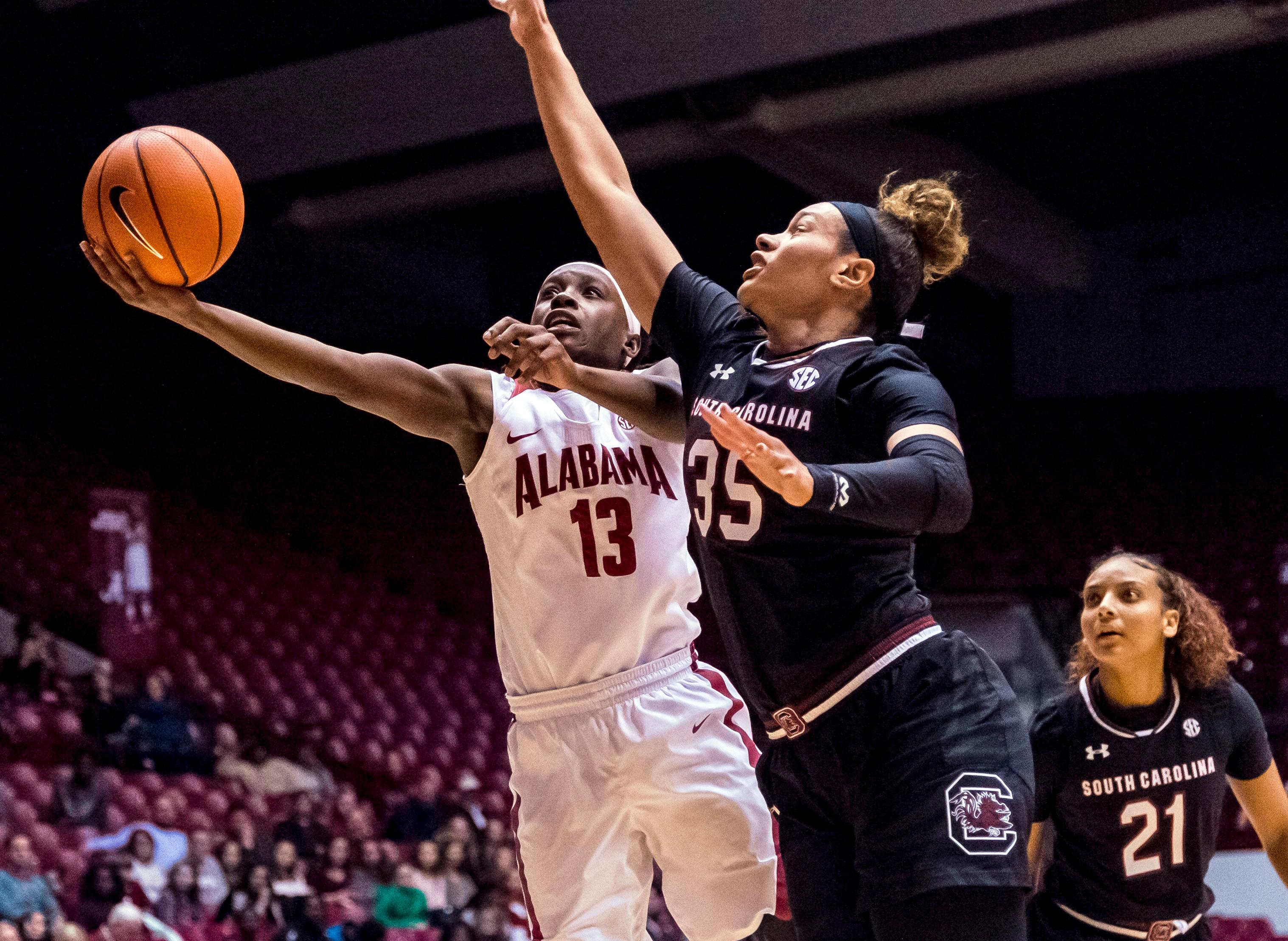Alabama guard Coco Knight (13) gets past South Carolina forward Alexis Jennings (35) for two points during an NCAA college basketball game Thursday, Feb. 8, 2018, in Tuscaloosa, Ala. (Vasha Hunt/AL.com via AP)