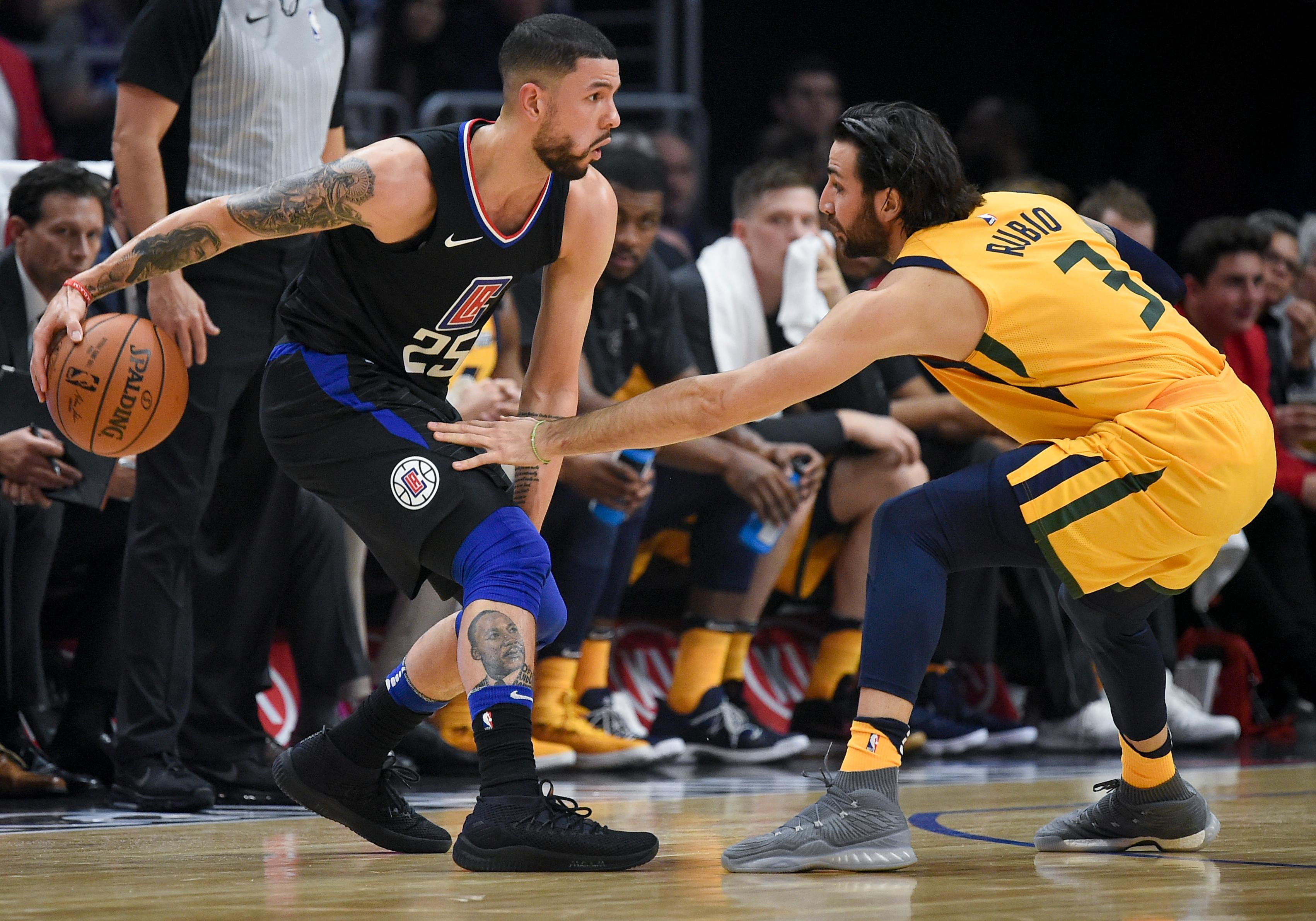 Los Angeles Clippers guard Austin Rivers, left, handles the ball as Utah Jazz guard Ricky Rubio defends during the first half of an NBA basketball game in Los Angeles, Thursday, Nov. 30, 2017. (AP Photo/Kelvin Kuo)