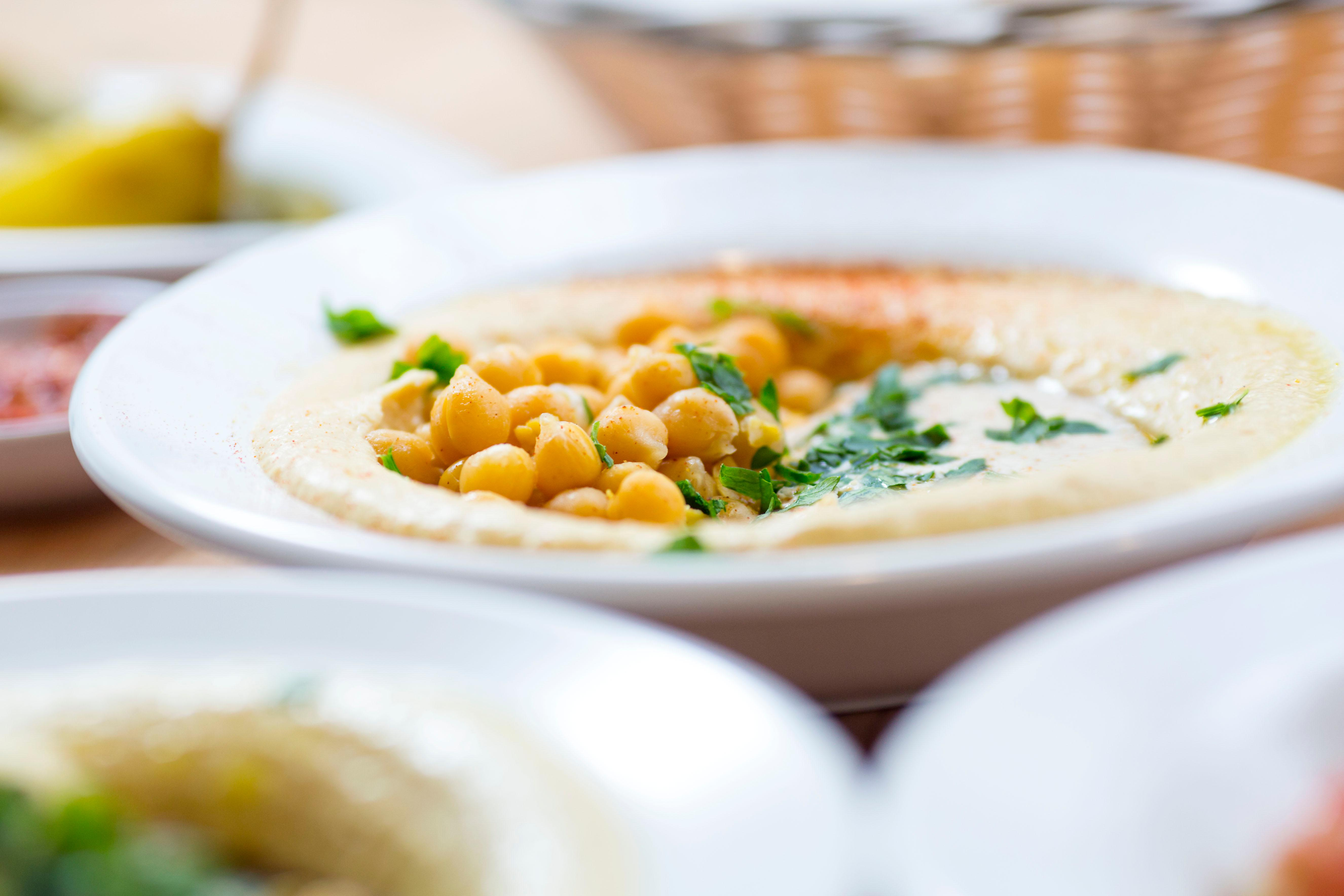 "The Classic - with tender boiled chickpeas and citrusy nutty tahina.{&nbsp;}<p></p><p>Aviv Hummus Bar is a 100% Israeli hummus bar, straight from the streets of Tel Aviv. And now, it's on Capitol Hill! Fun fact: Hummus literally means chickpeas. And while the west has kind of appropriated hummus and made it its own thing, traditional hummus isn't a sauce, or a dip, it's supposed to be a eaten as a meal consisting of smashed chickpeas, ""tahina"" and lemon. Enter Aviv Hummus Bar - trying to educate through this food. The Hummus Bar is located on 107 15th Ave E, Seattle. (Image: Sy Bean / Seattle Refined){&nbsp;}<br></p>"