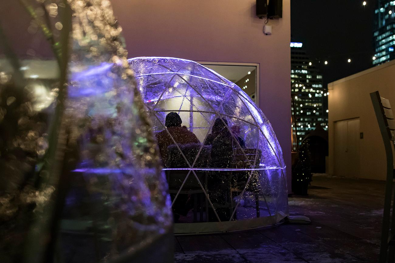 The igloos feature music and lights that are controlled via a remote. Reserving the igloo for 2 hours costs $250 and includes a choice of four appetizers. Drinks can be ordered without leaving the igloo by changing the color of the neon lights to grab the attention of bar staff. / Image: Allison McAdams // Published: 12.17.18
