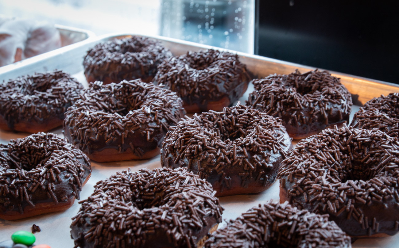 Chocolate frosted doughnuts with chocolate sprinkles{&nbsp;} / Image: Elizabeth A. Lowry // Published: 10.6.20<p></p>